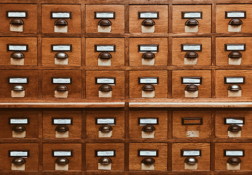 An old-school wooden card catalog at a library