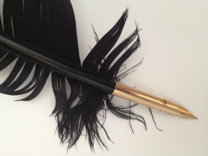 A black feather quill pen